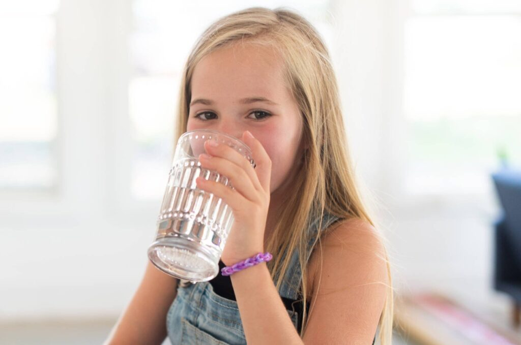 Girl Drinking Kinetico Water